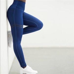 Beautiful blue leggings stripes on the right leg